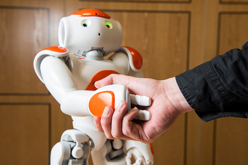 Photo: Shaking Hands And Cooperation In Tele-Present Human-Robot Negotiation